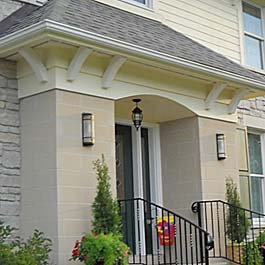 decorative cedar braces painted white holding overhang
